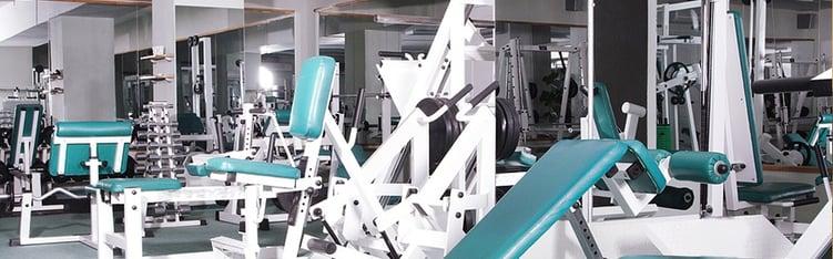 Health club cleaning - clean gym equipment
