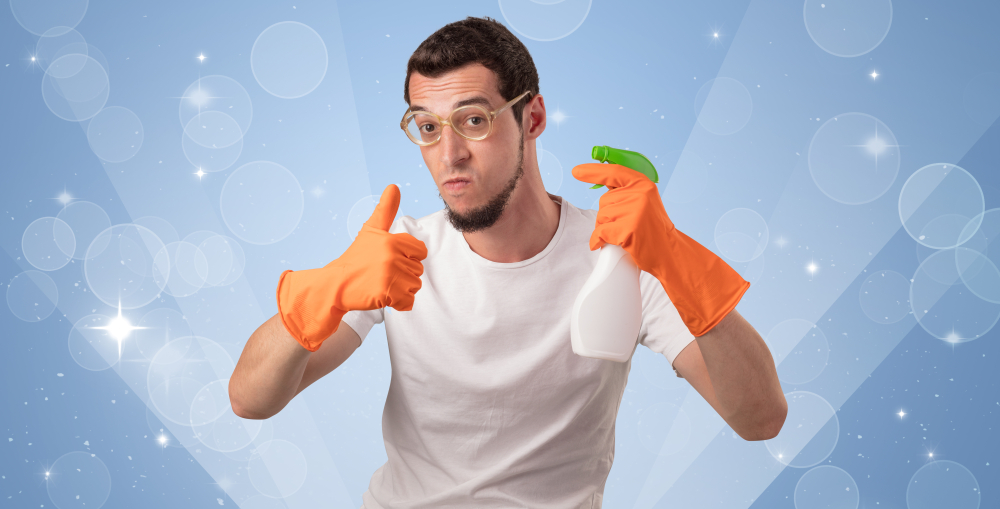 Office cleaner a glittered blue background with male housekeeper and cleaning equipment
