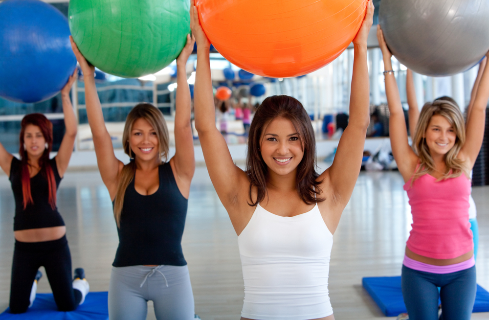 Health club cleaning for a group of women in a pilates class at the gym